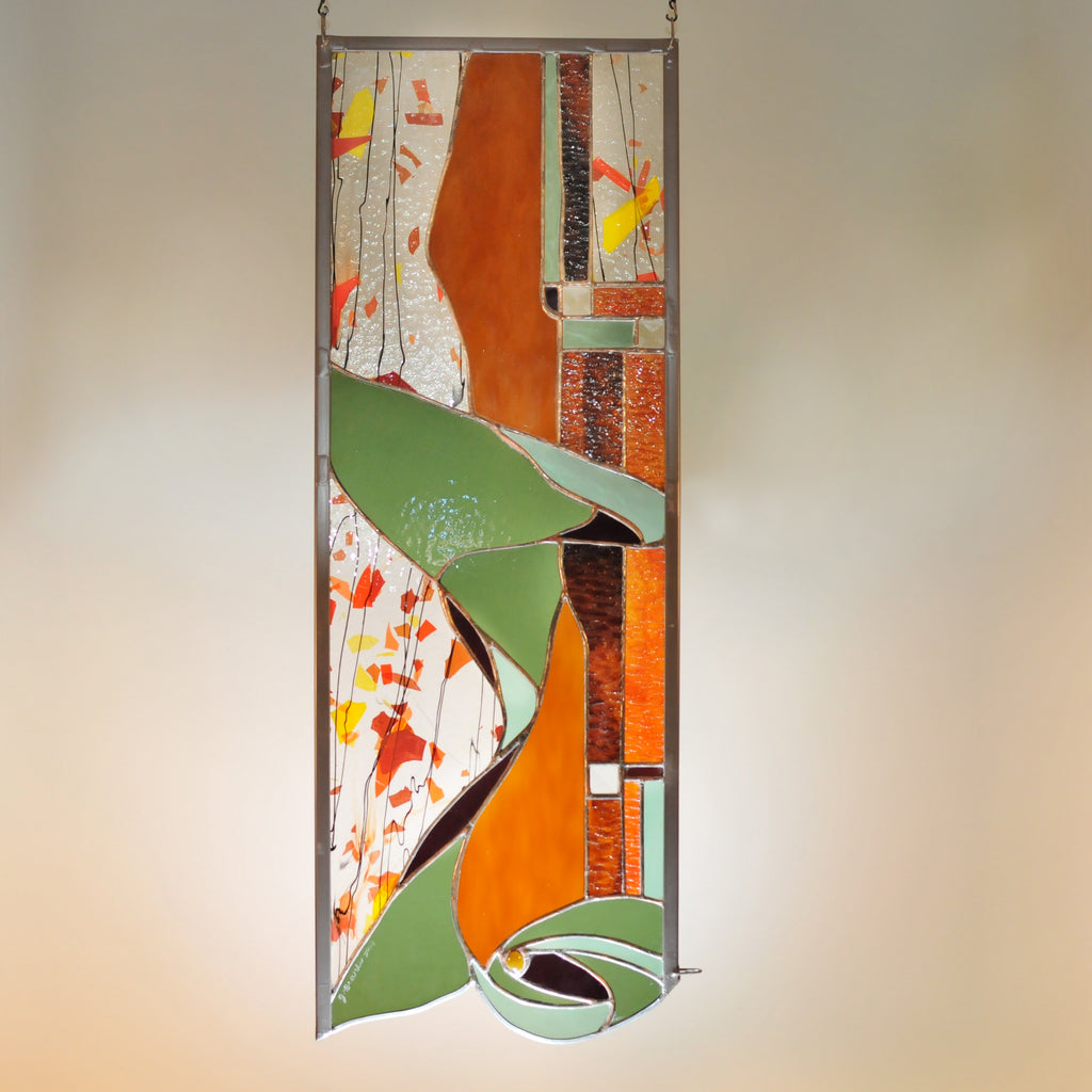 Large stained glass panel with Autumn colors and organic swirls made by Vermont artist Julia Brandis.