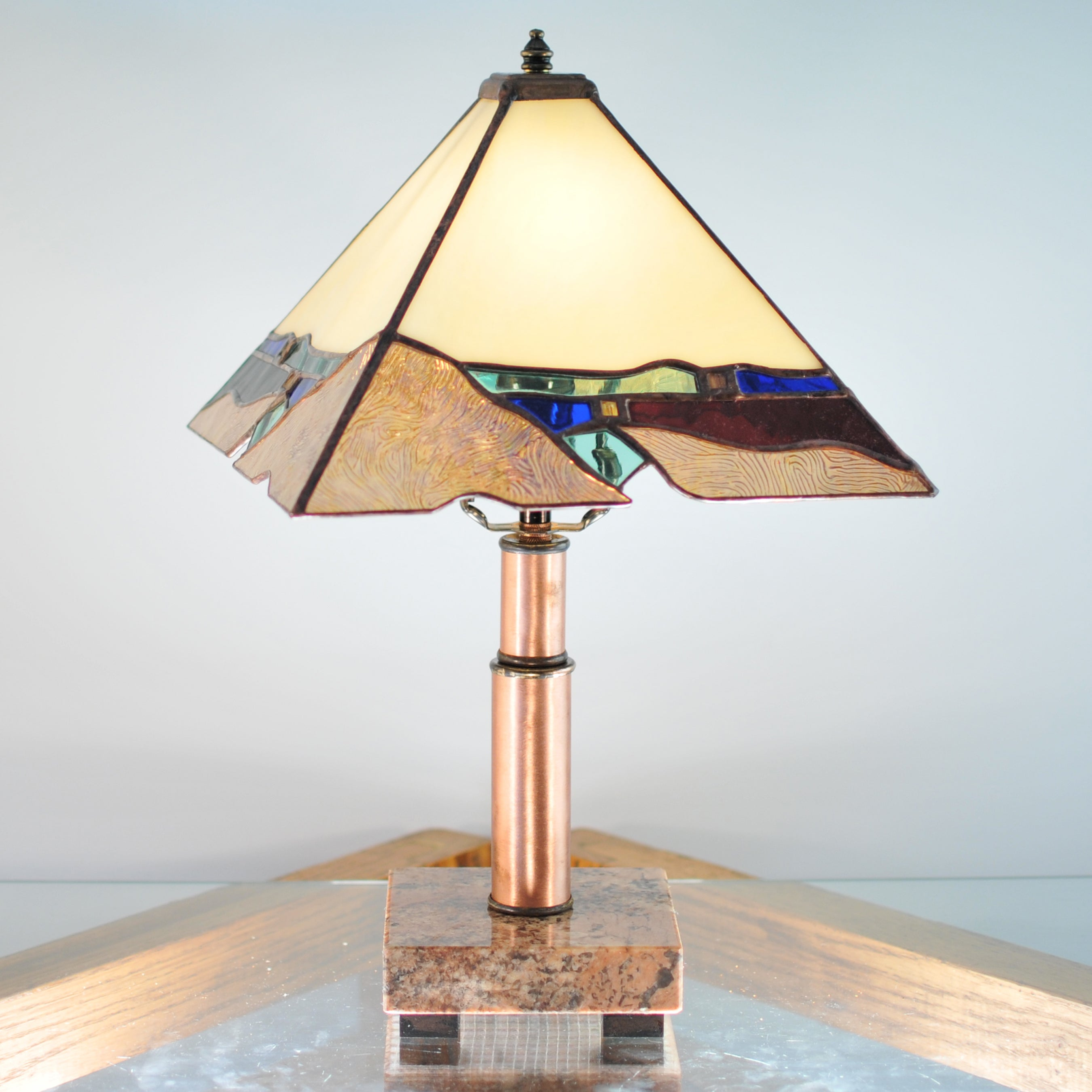 Small stained glass lamp with organic and architectural lines. Mission style / Prairie style.