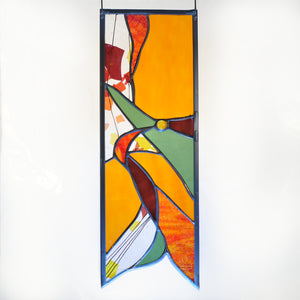 Small stained glass panel with autumn colors and organic swirls made by Vermont artist Julia Brandis.