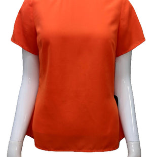 Short sleeve top by Michael Kors size S - BRAND: MICHAEL KORS. SIZE: S. STYLE: SHORT SLEEVE, POLY BLEND, PEPLUM BACK ZIP UP. COLOR: ORANGE. SKU: 40321024130.