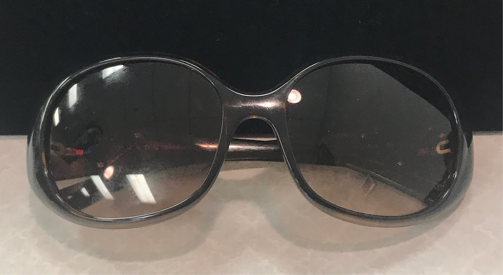 Sunglasses by Prada