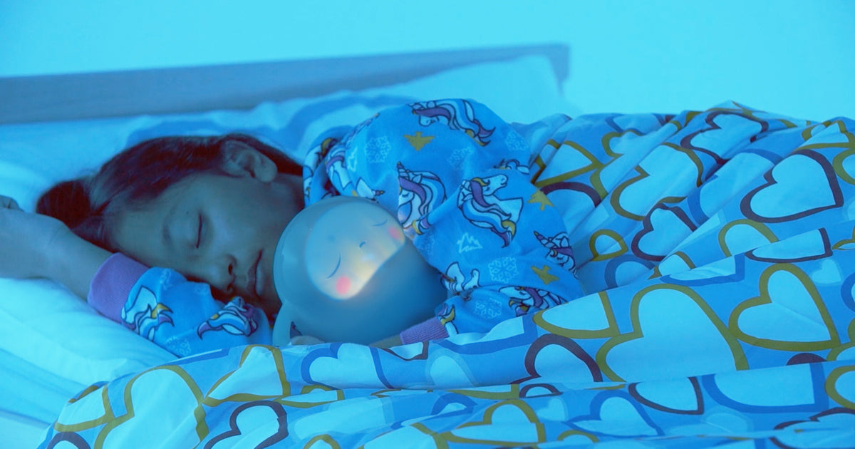 Child sleeping in bed with Snorble®.