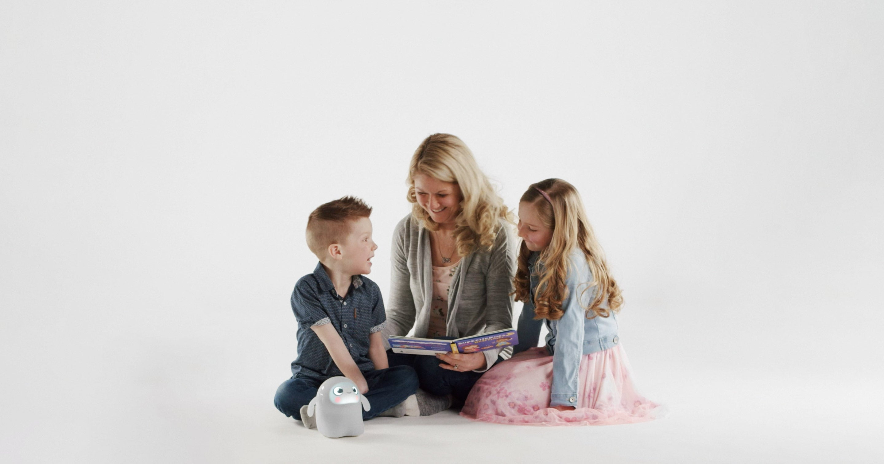 Mother reading to two children with Snorble®.