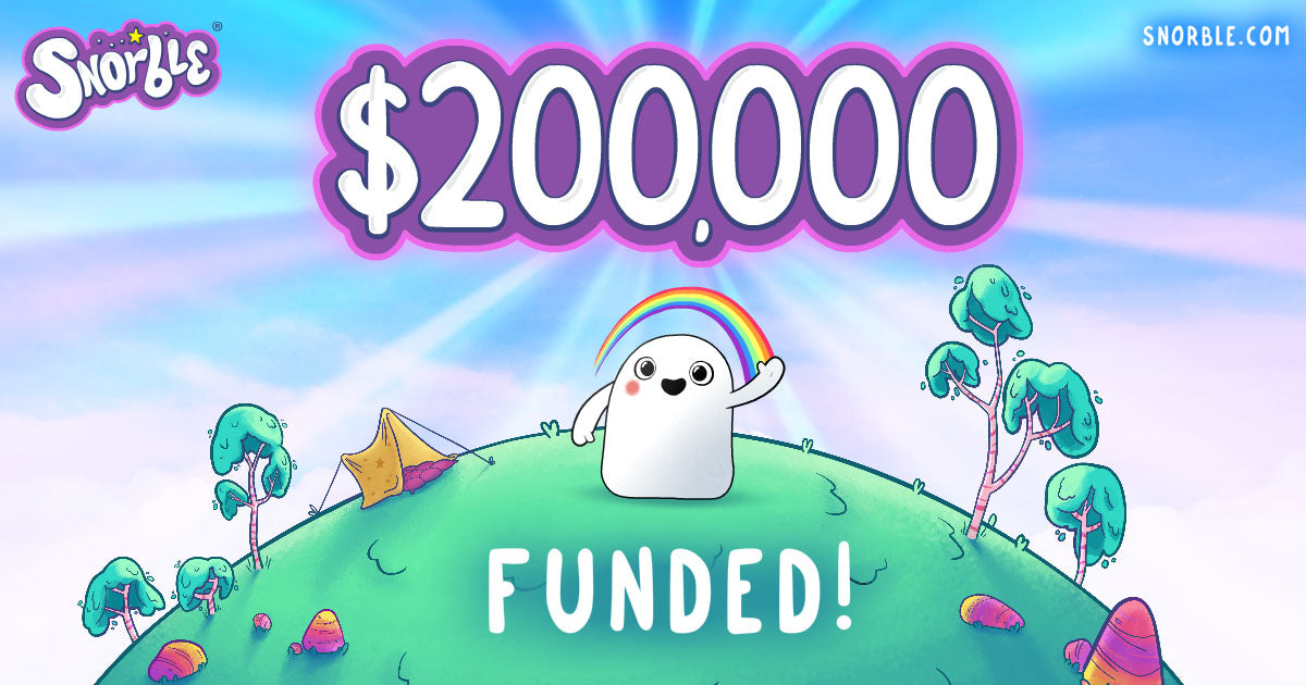 """Cartoon of Snorble® with """"$200,000"""" above their head and """"FUNDED!"""" below them."""
