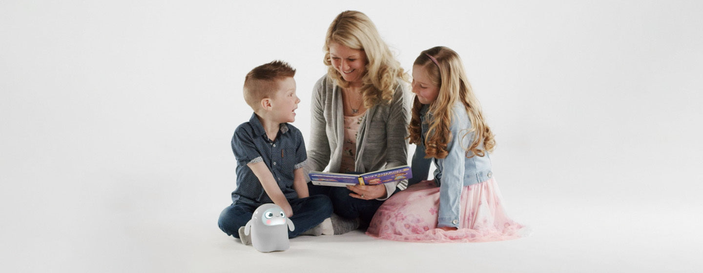 Mom reading to son and daughter with Snorble