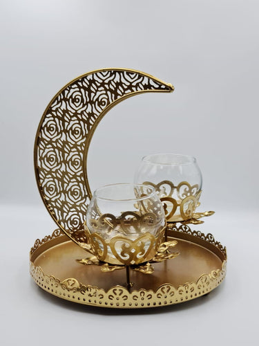 This Ramadan light up your home with this beautiful and elegant tray candle holder. The metal tray holder has Crescent Moon and two small candle holder sit in the middle.