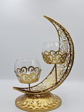 Load image into Gallery viewer, This Ramadan light up your home with this beautiful and elegant candle holder. The metal holder is in the shape of the Crescent Moon and two small candle holder sits in the middle.