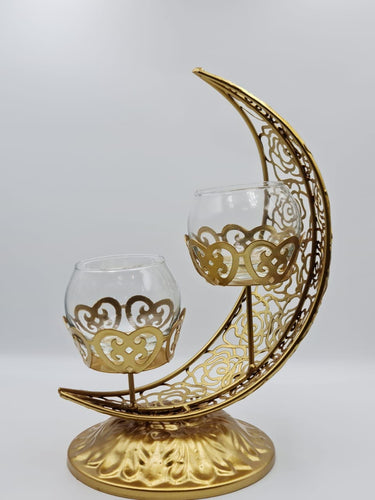 This Ramadan light up your home with this beautiful and elegant candle holder. The metal holder is in the shape of the Crescent Moon and two small candle holder sits in the middle.