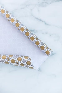This gorgeous metallic Geometric Gift Wrap is a show stopper! Perfect for Ramadan, Eid or any occasion. It's classic colors of black, white,  silver and gold metallic exudes elegance and chic! The geometric print is not overpowering, yet simple and clean.