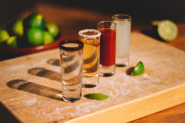 Three clear drinking glasses on a brown wooden table