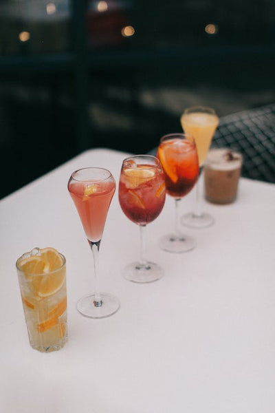 An assortment of cocktails lying on a table.