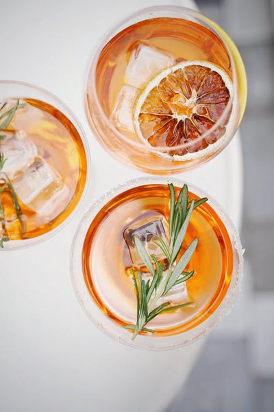 Cocktail with blood orange and rosemary.