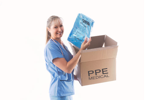 Nurse or doctor holding a Category 3 Type 5 disposable coverall hasmat suit PPE for infection control.