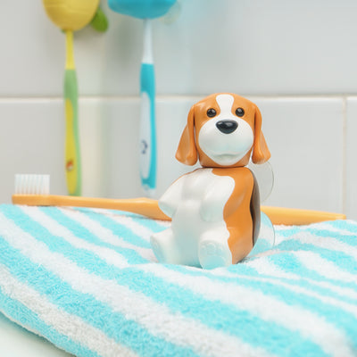 Beagle toothbrush cover on a blue and white towel.