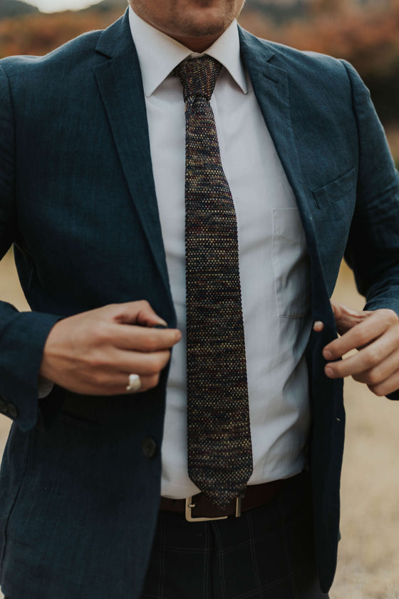 man wearing knit tie