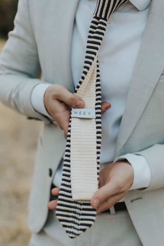 stripped men's knit tie on man