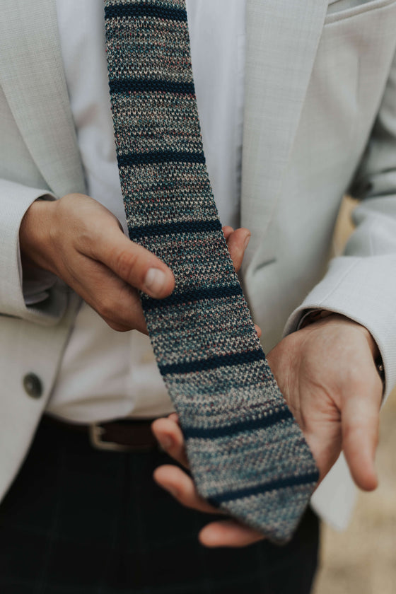 knit tie on man