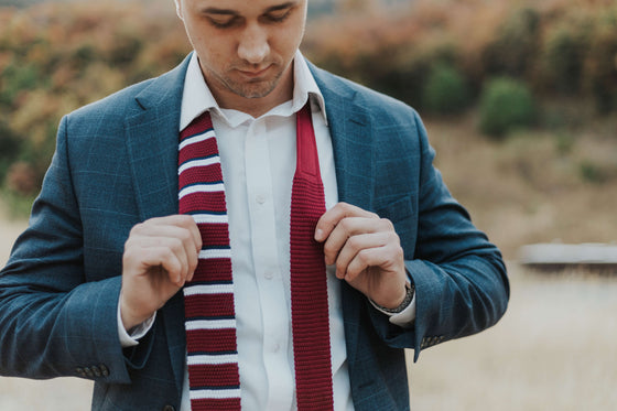 man wearing maroon knit tie