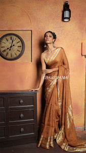 Look Stunning In This Tawny Brown Handwoven Linen Saree.Linen Saree Is Graceful Attire For Any Season And Occasion. Pure Handloom Linen Saree Is Perfect Blend Of Elegance And Comfort.