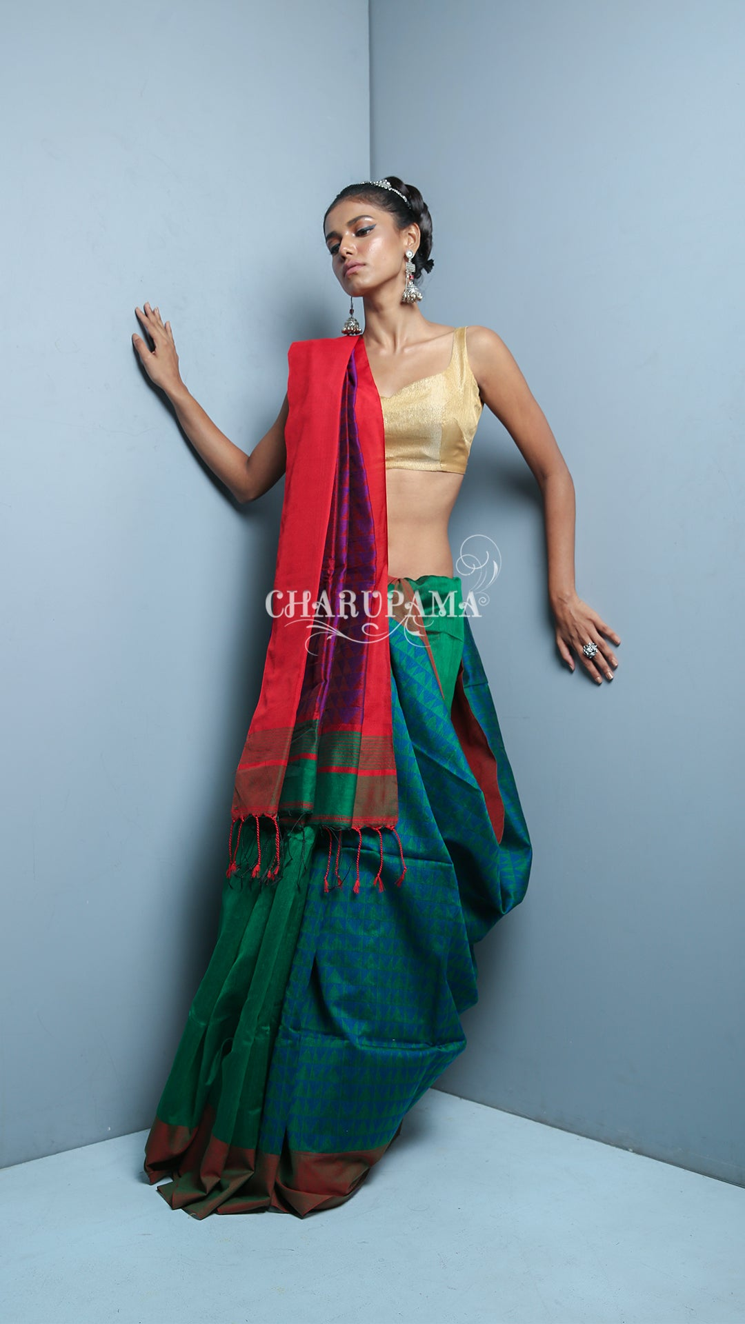 This Green And Teal Blue Double Shade Blended Cotton Saree Is Half Plain And The Othe Half Is Weaved, It Has The Comfort Factor For Daily Wear And Easy Home Care.