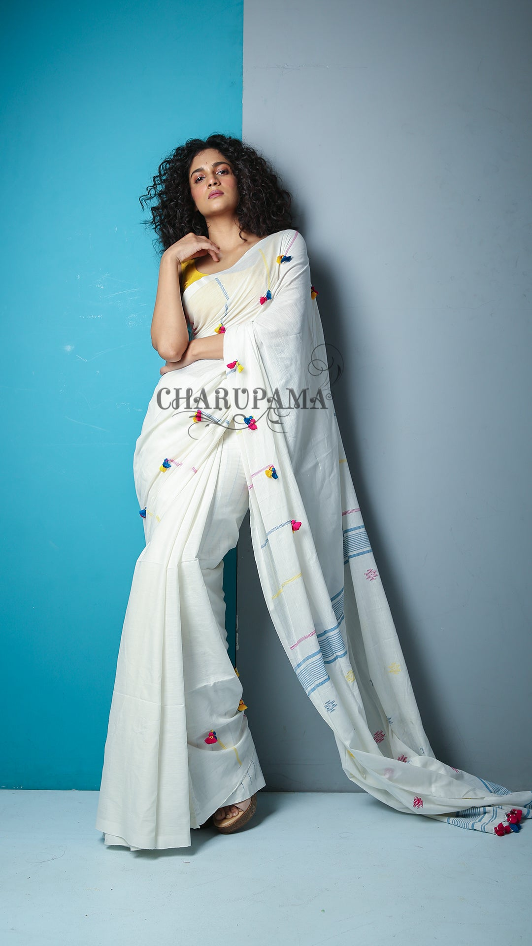 This Pure Cotton Saree Is Made In Handloom And The Fabric Is Cotton Which Gives You Comfort With Style. Add On Feature Is Multicolor Thread Weaving And Pompom On Body And Pallu. Perfect For Summer - Charupama