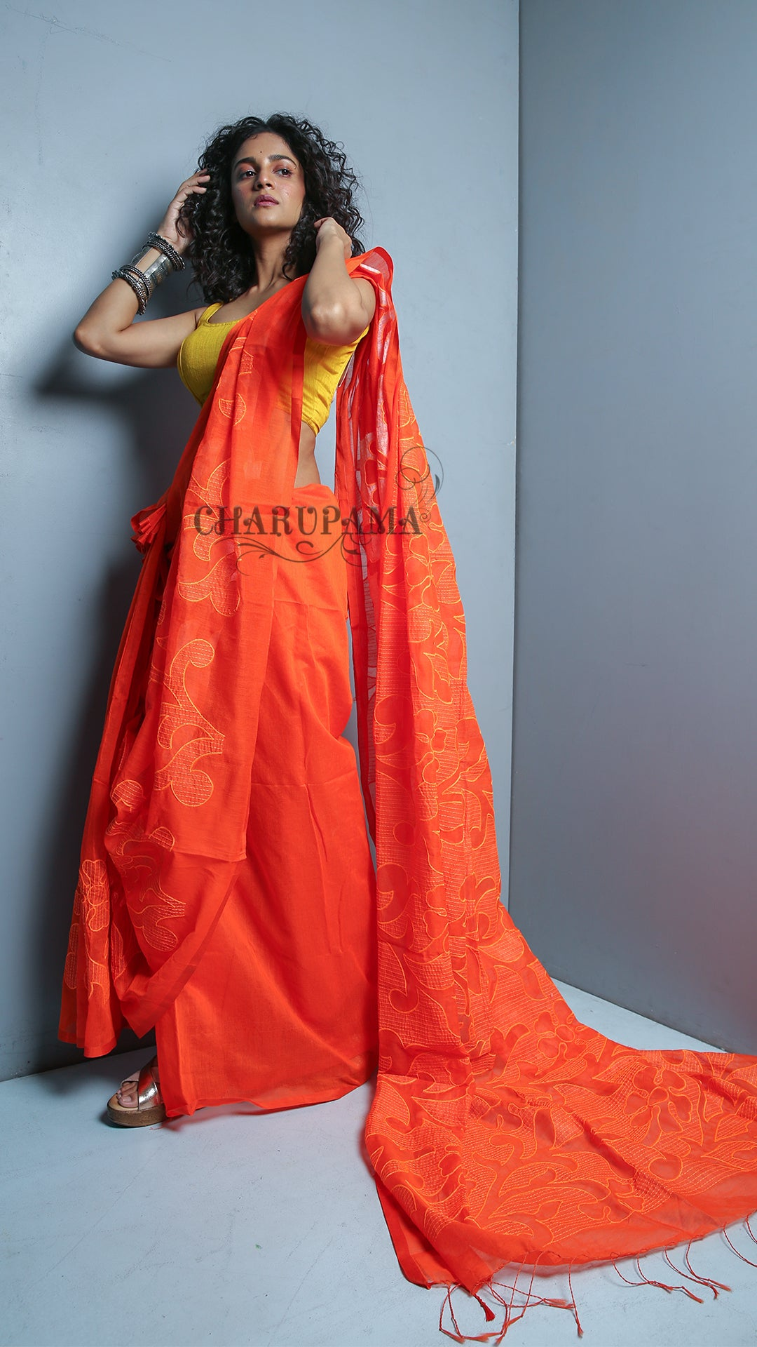 Bright Orange Blended Cotton Saree With Self Thread Embroidered Floral Design And No Border.