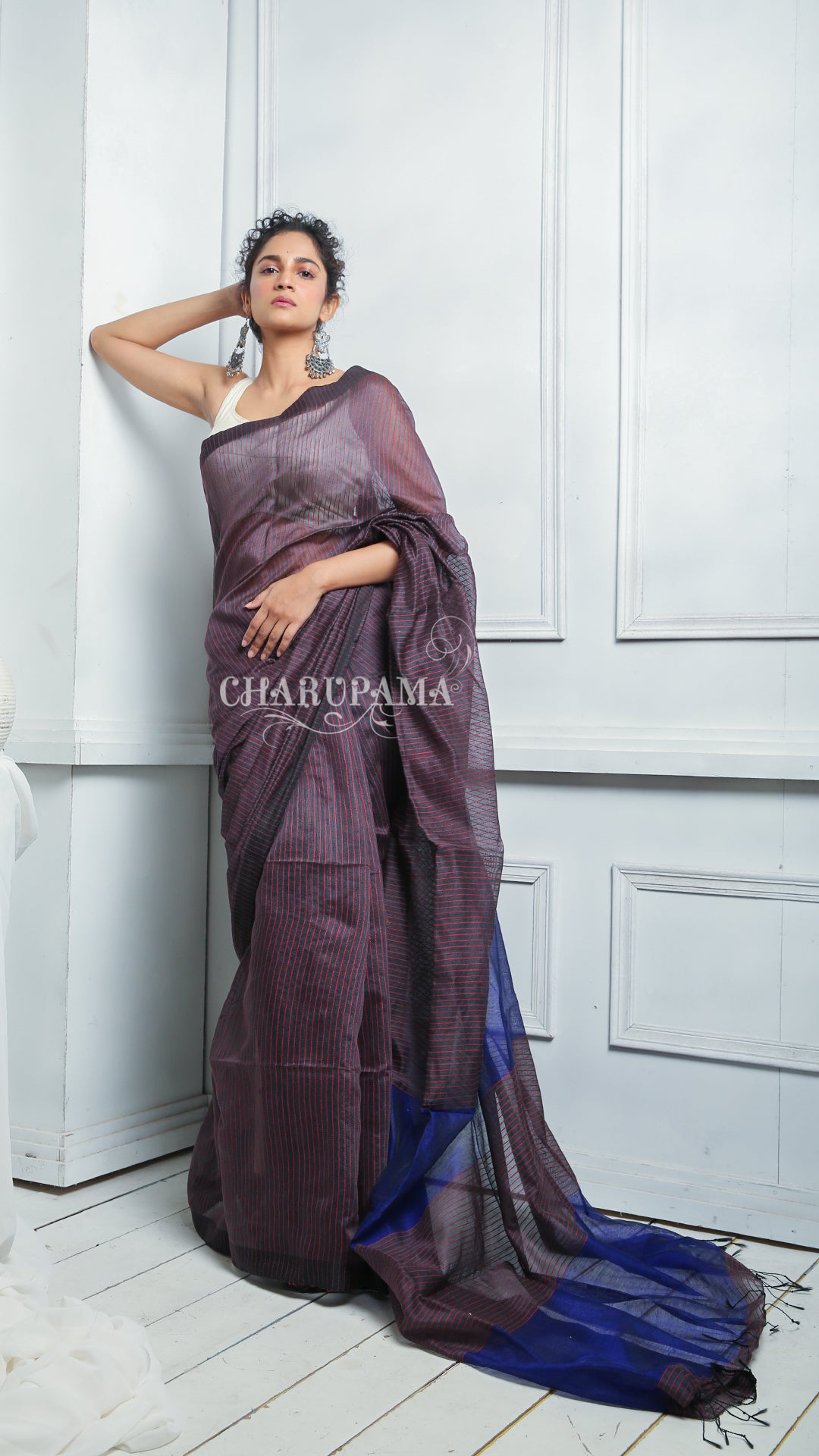 This Handloom Blended Cotton Saree Is Weaved Using Dual Tone Thread. Very Light Weight Saree And Pallu Is Styled By Thin Strips Of The Thread