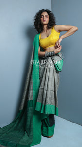 Steel Grey And Green Border Design. Cotton Ghicha Saree Is Traditional And Yet Rather Contemporary. Very Light Weight Pallu Is Styled By Thin Strips Of The Thread And Zari - Charupama
