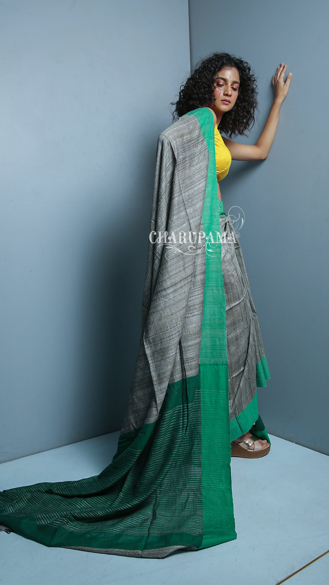 Charupama - Steel Grey And Green Border Design. Cotton Ghicha Saree Is Traditional And Yet Rather Contemporary. Very Light Weight Pallu Is Styled By Thin Strips Of The Thread And Zari.