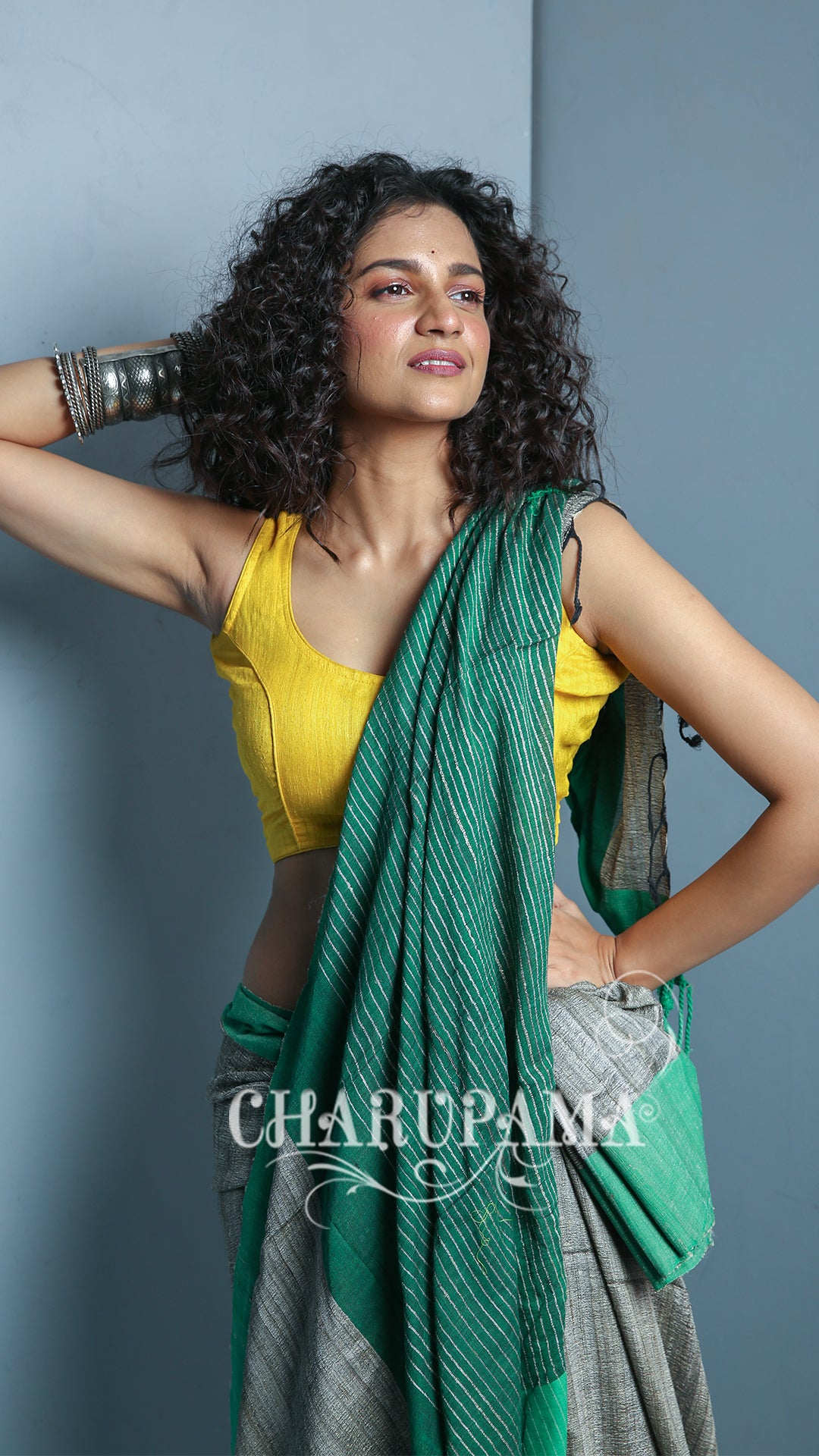 With Yellow Blouse - Steel Grey And Green Border Design. Cotton Ghicha Saree Is Traditional And Yet Rather Contemporary. Very Light Weight Pallu Is Styled By Thin Strips Of The Thread And Zari.