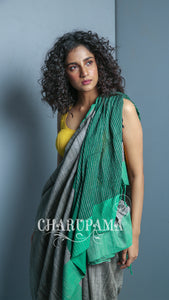 Steel Grey And Green Border Design. Cotton Ghicha Saree Is Traditional And Yet Rather Contemporary. Very Light Weight Pallu Is Styled By Thin Strips Of The Thread And Zari by Charupama