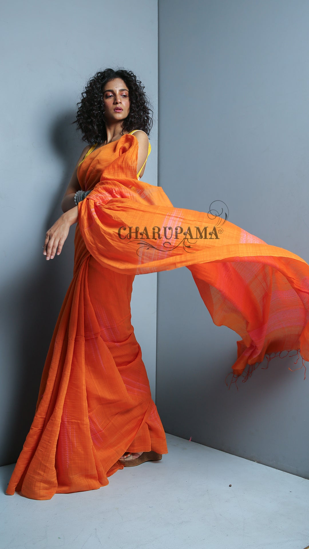 This Bright Orange Shade Cotton Silk Saree Is As Light As Feather. Look Elegant In This Fade Peach Shibori Printed Handwoven Saree - Charupama