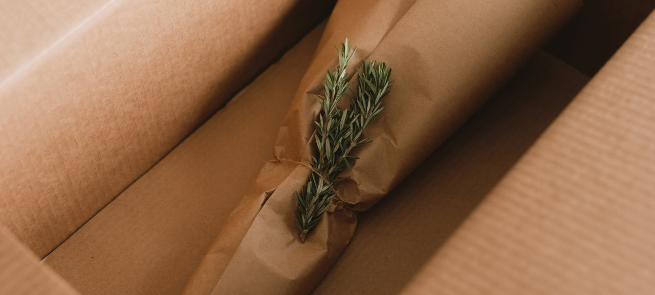 Recycled and recyclable shipping materials with rosemary and twine