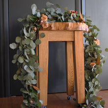 Garland is handtied with biodegradable twine—a fittinglGarland with Eucalyptus Spray Roses Seasonal Berries Magnolia leaves and handtied with twine