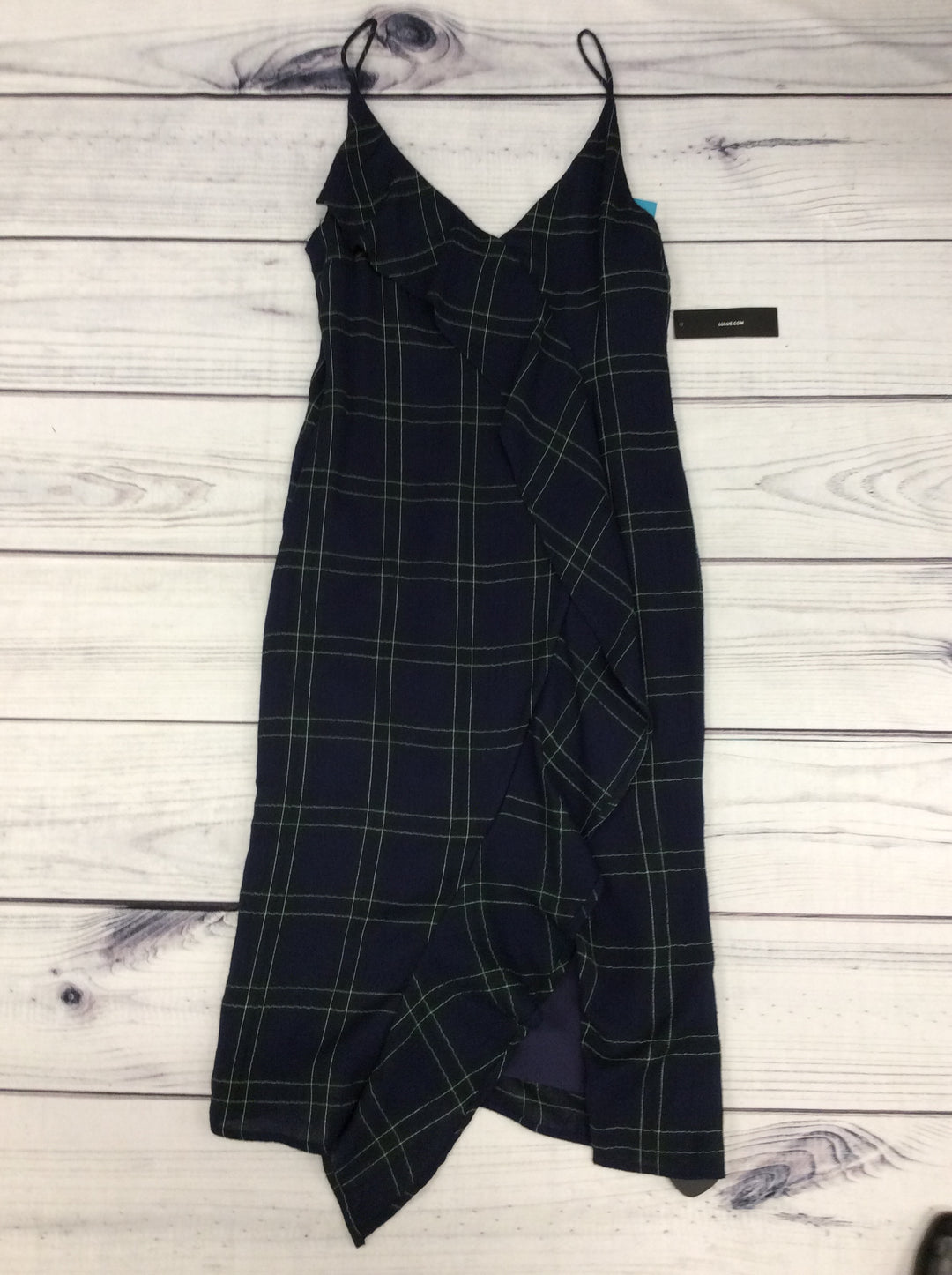 NWT Lulus Dress - <UL> <LI>SIZE MEDIUM</LI> <LI>V-NECK FRONT AND BACK</LI> <LI>SLEEVELESS</LI> <LI>PLAID DESIGN WITH RUFFLE GOING DOWN THE FRONT OF DRESS</LI> <LI>NAVY, GREEN, BLACK, EXPOSED IVORY STITCHING</LI> </UL>