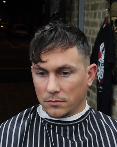 Textured Fringe Haircut For Men With Faded Undercut