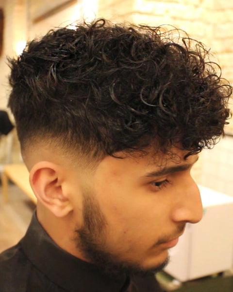 Low Skin Fade Curly Haircut With Disconnected Undercut Video