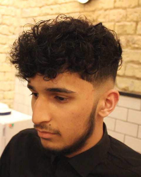 Low Skin Fade Curly Haircut With Disconnected Undercut - VIDEO