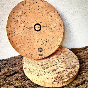 Green Blue World 20cm diameter round pot mat / trivet. Beautiful natural cork product. One side laser etched with GBW logo & Natureza Ibérica ecolabel, the other side natural. Made by artisans from a regenerative forestry project, for eco living.