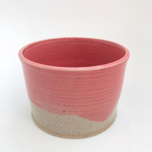 A pink and speckled clay cover pot inspired by the Bahamas made by NZ potter Blackshed Pottery