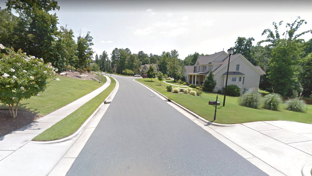 Suburban neighborhood with manicured lawns in Wake Forest, NC.