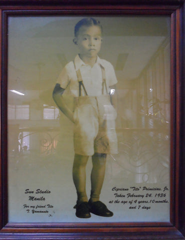 Cipriano Primicias Jr. at 4 years of age, wearing shorts with suspenders.