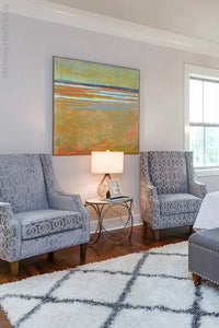"Zen abstract coastal wall art ""Amber Keys,"" downloadable art by Victoria Primicias, decorates the bedroom."