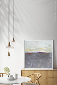 "Neutral color abstract coastal wall decor ""Fog Island,"" digital artwork by Victoria Primicias, decorates the dining room."