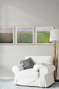 "Square abstract coastal wall art ""Kelly Corridor,"" digital print by Victoria Primicias, decorates the living room."