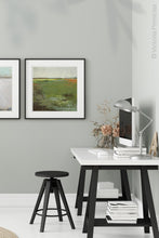 "Load image into Gallery viewer, Green abstract landscape painting ""Spring Envy,"" fine art print by Victoria Primicias, decorates the office."