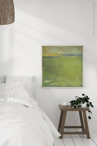 "Yellow-green abstract landscape art ""Above Anything,"" metal print by Victoria Primicias, decorates the bedroom"