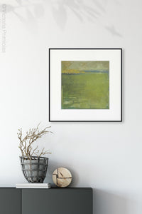 "Yellow-green abstract landscape painting ""Above Anything,"" wall art print by Victoria Primicias, decorates the entryway."