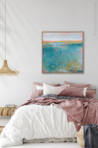 "Teal abstract beach art ""Admiral Straits,"" digital print by Victoria Primicias, decorates the bedroom."