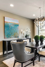 "Load image into Gallery viewer, Teal abstract seascape painting ""Admiral Straits,"" digital print by Victoria Primicias, decorates the dining room."